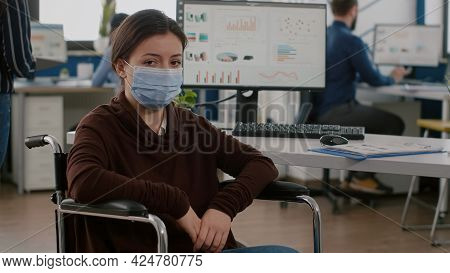 Woman Employee With Disabilities, Invalid, Handicapped Paralized With Protection Mask Against Corona