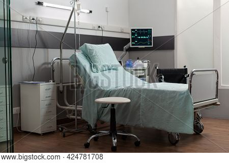 Empty Bed In Hospital Room With Medical Equipment. Clean Sterile Enironment In Private Ward. Modern