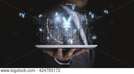 Businessman Holding Tablet With Virtual Infographic Technology And Yuan Currency Sign , Digital Yuan