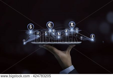Businessman Hand Holding Tablet With Virtual World Map Connection Line And Global Currency , Technol