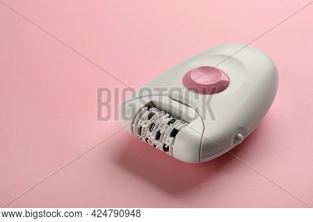Modern Epilator On Pink Background, Space For Text