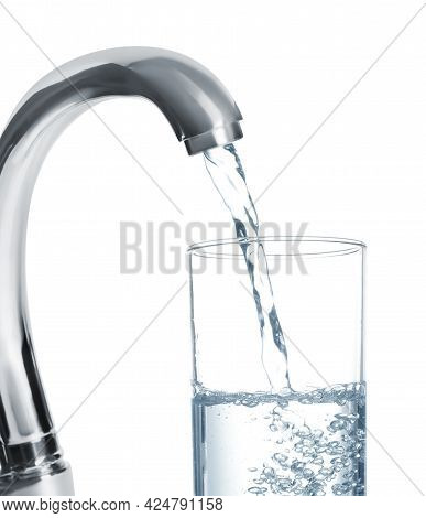 Filling Glass With Water From Tap On White Background