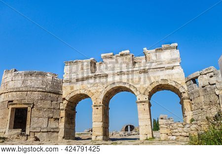 Domitian Gates With Towers On Frontinus Street Of Antique City Hierapolis, Pamukkale, Turkey. Built
