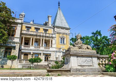 Panorama Of Massandra Palace In Baroque Style With Its Park And Statue Of Sphinx With Female Head. B