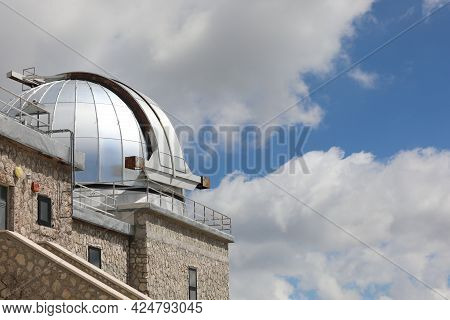 Large Steel Dome With The Telescope Of The Astronomical Observatory In The Mountains For The Observa