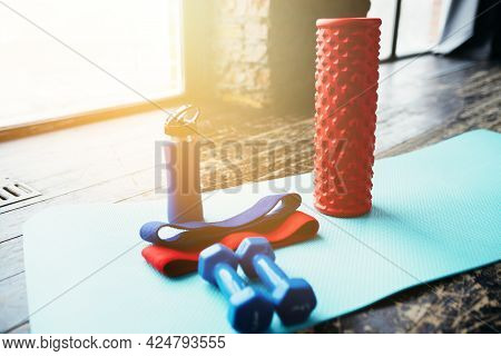 Sports Equipment, Dumbbells, Elastic Band, Fascia Roll Lie On The Yoga Mat. Flatley In A Loft Fitnes