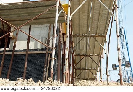 Scaffolding Of The Construction Site During The Renovation Of A Building With Energy Saving Material