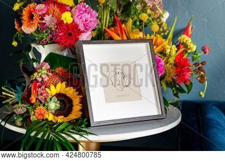 Flowers surrounding photo frame mockup