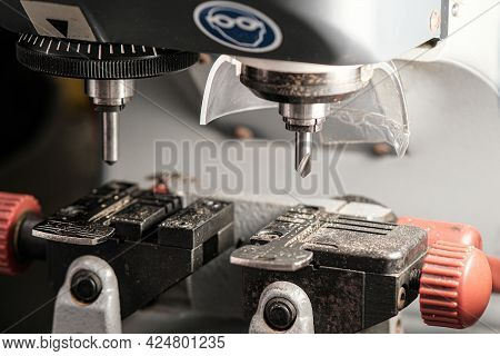 A Copy Machine For Making Keys. A Milling Cutter For Cutting A Duplicate. The Locksmiths Theme. Key