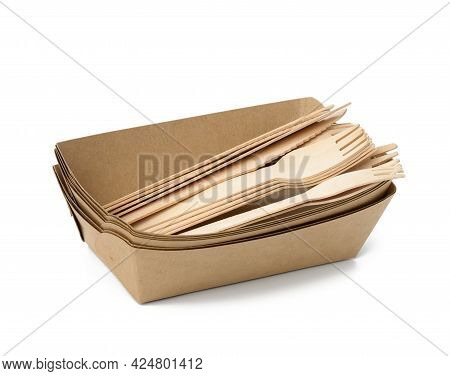 Wooden Fork And Empty Brown Disposable Plate Made From Recycled Materials On A White Background, Top