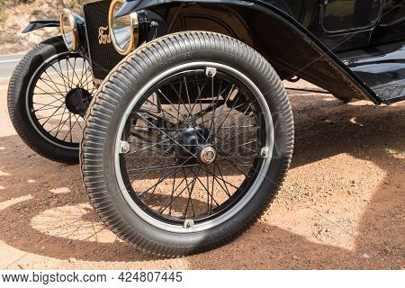 Franschhoek, South Africa - April 12, 2021: Wheel Of A Model-t Ford From 1915. Franschhoek Pass In T