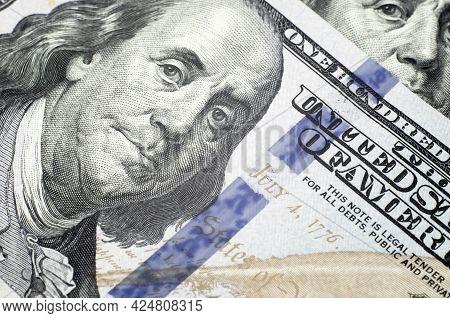 100 Dollar Bill Close Up. Part Of A New Hundred Dollar Bill. Benjamin Franklin Close-up Portrait