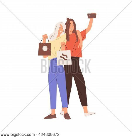 Young Happy Women With Shopping Bags Taking Selfie Photo With Mobile Phone. Smiling Hugging Girlfrie