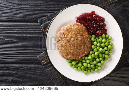 Rich And Delicious Swedish Veal Patties Wallenbergare With Boiled Green Peas Closeup In The Plate On