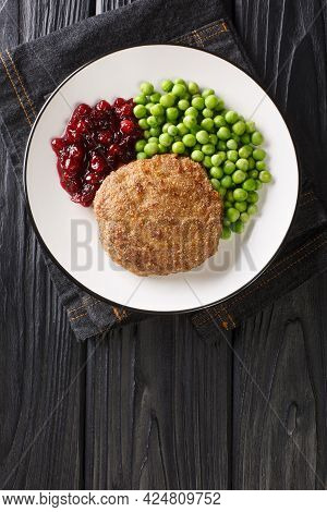 Veal Burger With Green Peas And Lingonberry Jam Close-up In A Plate On The Table. Vertical Top View