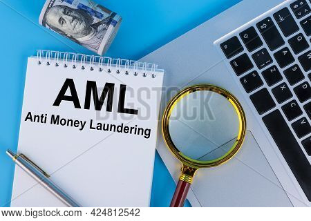 Conceptual Image Of Business Acronym Aml Anti Money Laundering, Written In A Notebook Lying On A Tab