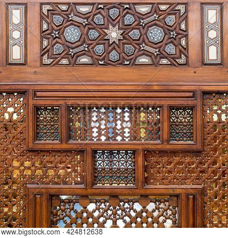 Arabesque Ornaments Of An Old Aged Decorated Wooden Wall, Old Cairo, Egypt