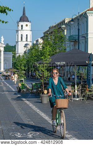 Vilnius, Lithuania - June 22 2022: Girl Cycling On The Road Bike In Vilnius City Center Reopening Wi
