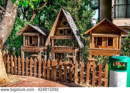 Wooden Houses-feeders For Animals In The Park Of Alanya (turkey). Three Small Constructions With Bre