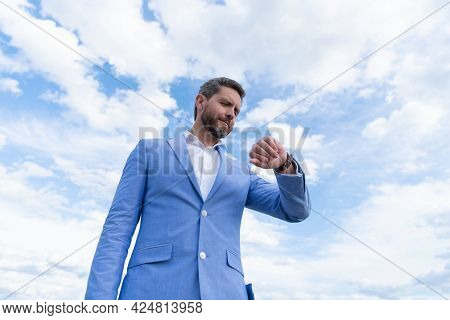 Man In Businesslike Blue Suit And Wristwatch. Punctuality. Manager Check Time.