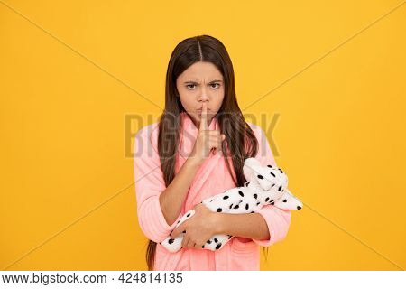 Teen Girl In Home Terry Bathrobe With Toy Showing Hush Gesture, Keep Silence
