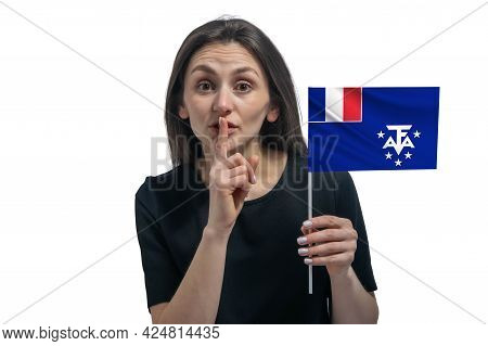 Happy Young White Woman Holding Flag Of French Southern And Antarctic Territories And Holds A Finger
