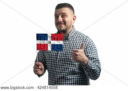 White Guy Holding A Flag Of Dominican Republic And Shows The Class By Hand Isolated On A White Backg