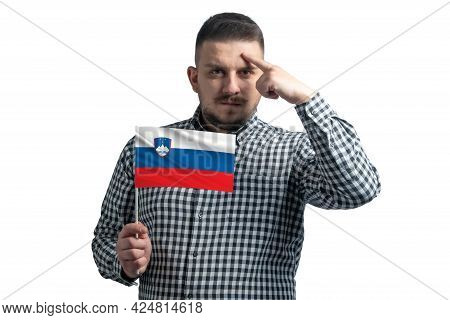 White Guy Holding A Flag Of Slovenia And A Finger Touches The Temple On The Head Isolated On A White