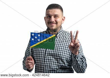 White Guy Holding A Flag Of Solomon Islands And Shows Two Fingers Isolated On A White Background.