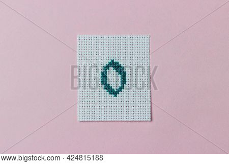 Green Number 0 Cross-stitch Embroidered On Piece Of Canvas In Center Of Pink Background. Hobby