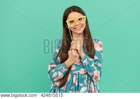 Keep Smiling. Happy Child Smile Holding Prop Glasses. Happy Childhood And Girlhood