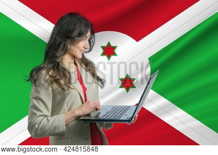 Freelance In Burundi. Beautiful Young Woman Freelancer Uses Laptop Computer Against The Background O