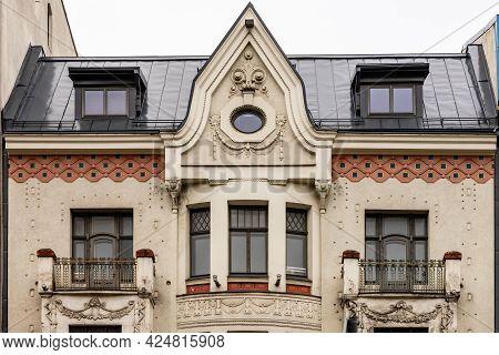 Detail Of Grey Cream Orange Art Nouveau Building´s Facade Of Eight Windows, Balconies And Artsy Deco