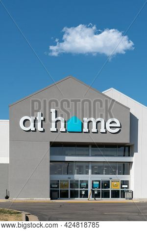 At Home Home Décor Superstore Exterior And Trademark Logo