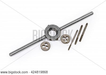 Different Old Thread Cutting Dies, Die Holder And Plug Taps On A White Background, Close-up