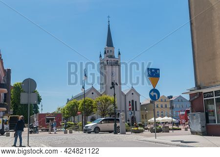 Bytow, Poland - May 31, 2021: View Of The Entrance To The Market Square And The Church Of St. Cather