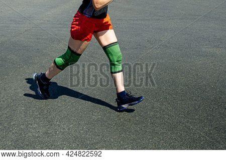 Legs Elderly Female Runner In Knee Pads Run Race