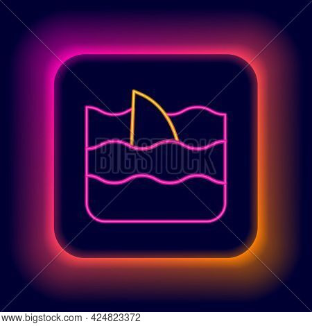 Glowing Neon Line Shark Fin In Ocean Wave Icon Isolated On Black Background. Colorful Outline Concep
