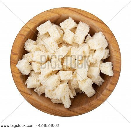 Bread Rusks. Fried Pieces Of Bread In A Wooden Bowl Isolated On White Background. Caesar Salad Ingre