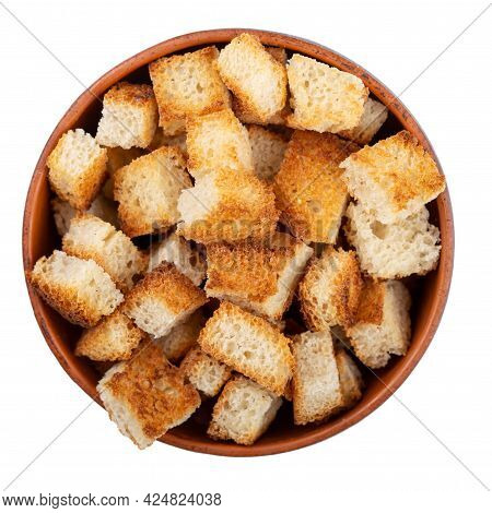 Bread Rusks. Fried Pieces Of Bread In A Clay Bowl Isolated On White Background. Caesar Salad Ingredi