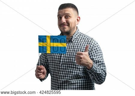 White Guy Holding A Flag Of Sweden And Shows The Class By Hand Isolated On A White Background. Like