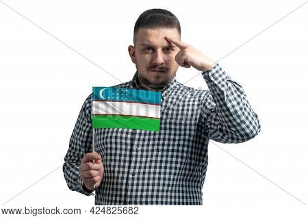 White Guy Holding A Flag Of Uzbekistan And A Finger Touches The Temple On The Head Isolated On A Whi