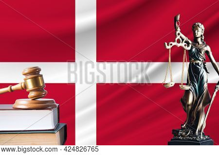 Law And Justice In Denmark. Statue Of Themis And The Gavel Of The Judge Against The Background Of Th