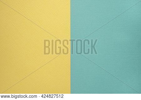 Two Colored Papers With A Blue And Yellow Overlay On The Floor. They Divide Half Of The Image. Dual