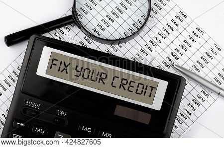 Fix Your Credit Text On Calculator With Magnifier On Chart Background,business