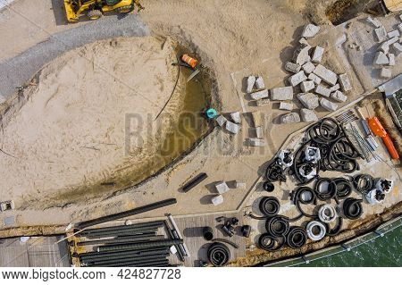 Aerial View Reconstruction Maintenance Of Pier Boardwalk On Replacement View A Stack Black Pvc Sewer