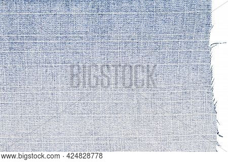 Piece Of Blue Jeans Fabric Isolated On White Background. Rough Uneven Edges. Denim Pants Torn. Back