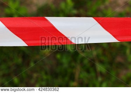 Red And White Restrictive Tape At The Scene Of An Emergency