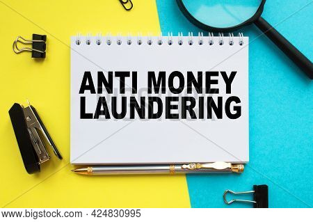 A Notepad With Text Anti Money Laundering On The Office Desk With Stationery. A Blank Notepad For En