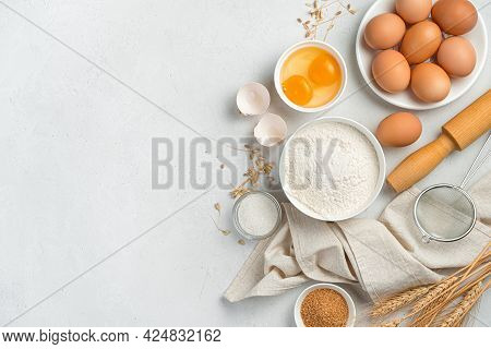Ingredients For Making Dough Dishes: Cakes, Cookies, Pizza, Pasta On A Gray Background. Flour, Eggs,